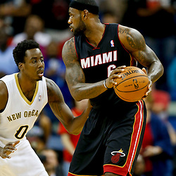 Oct 23, 2013; New Orleans, LA, USA; Miami Heat small forward LeBron James (6) is guarded by New Orleans Pelicans small forward Al-Farouq Aminu (0) during the second half of a preseason game at New Orleans Arena. The Heat defeated the Pelicans 108-95. Mandatory Credit: Derick E. Hingle-USA TODAY Sports