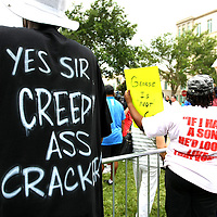 "A pro-Trayvon demonstrator wears a t-shirt that says ""Yes sir, creepy ass cracker"", in the protest area, prior to the trial of George Zimmerman at the Seminole County Courthouse, Saturday, July 13, 2013, in Sanford, Fla. Zimmerman had been charged for the 2012 shooting death of Trayvon Martin. Zimmerman was found not guilty by a jury of six women. (AP Photo/Alex Menendez)"