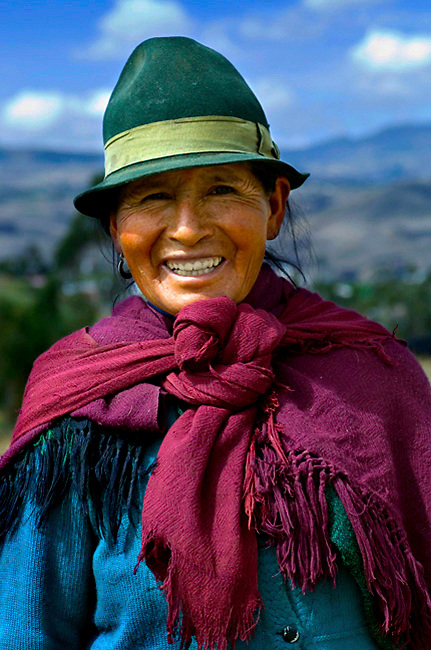 Felt brown hat and shawl identify this indigenous woman's ethnicity and tradtions in the Andes of Ecuador.