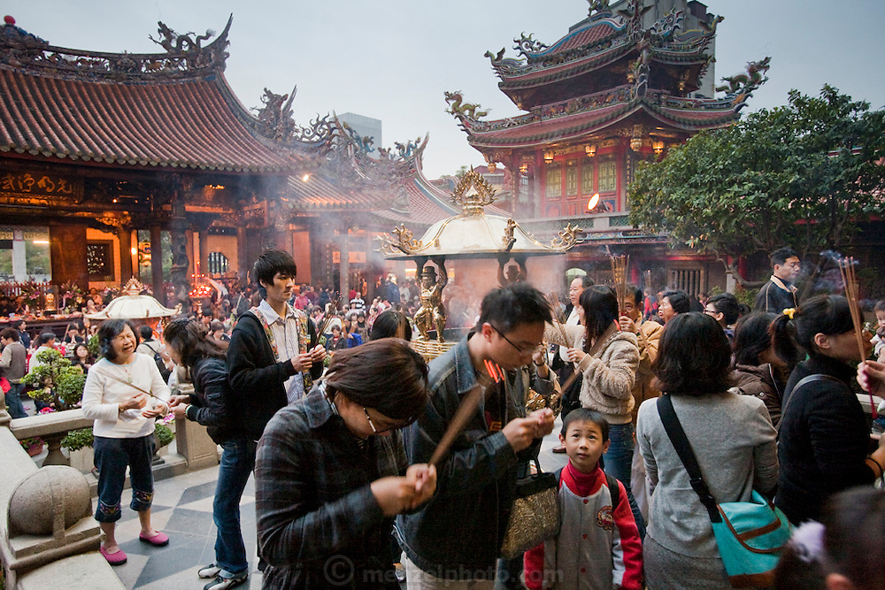 Worshipers go through religious rituals at Longshan Temple in Taipei, Taiwan.