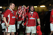 Wales players Gethin Jenkins (l) and Adam Jones celebrate with the trophy. RBS Six nations championship 2013, Wales v England at the Millennium stadium in Cardiff , South Wales on Saturday 16th March 2013. pic by Andrew Orchard, Andrew Orchard sports photography,
