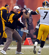 MORNING JOURNAL/DAVID RICHARD.Pittsburgh head coach Jim Cower, left, and quarterback Ben Roethlisberger celebrate a Steelers' touchdown yesterday in the second half.
