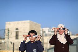 60670636 <br /> Palestinian look at the partial solar eclipse in the West Bank City of Ramallah, Sunday November 3 2013. Picture by  imago / i-Images.<br /> UK ONLY