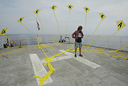 "LUTZ TRECZOCKS WITH HIS YELLOW ""STOP PLUTONIUM"" KITE, MVAS, JAPAN. 030702. .PIC © JEREMY SUTTON-HIBBERT/GREENPEACE 2002..*****ALL RIGHTS RESERVED. RIGHTS FOR ONWARD TRANSMISSION OF ANY IMAGE OR FILE IS NOT GRANTED OR IMPLIED. CHANGING COPYRIGHT INFORMATION IS ILLEGAL AS SPECIFIED IN THE COPYRIGHT, DESIGN AND PATENTS ACT 1988. THE ARTIST HAS ASSERTED HIS MORAL RIGHTS. *******"