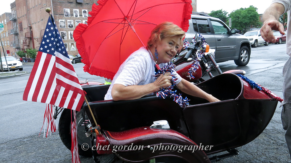 City of Newburgh Mayor Judy Kennedy sits in a motorcycle sidecar after riding in the Newburgh 150th. Anniversary parade in Newburgh, NY on Thursday, June 25, 2015. Kennedy, the incumbent mayor will face fellow Democratic challengers Councilwoman Gay Lee, and Jonathan Jacobson, the former Orange County and Newburgh Democratic Committee Chairman.  © Chet Gordon • Photographer