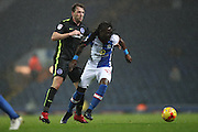 Blackburn Rovers striker, Marvin Emnes (17)  and Brighton & Hove Albion central midfielder Dale Stephens (6) during the EFL Sky Bet Championship match between Blackburn Rovers and Brighton and Hove Albion at Ewood Park, Blackburn, England on 13 December 2016.