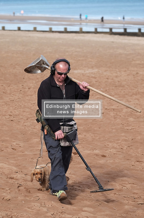 A man uses a metal detector on Portobello Beach in Edinburgh during a sunny first day of Autumn.<br /> <br /> Edinburgh Weather Pictures, Thursday 22nd September 2016<br /> <br /> (c) Alex Todd | Edinburgh Elite media