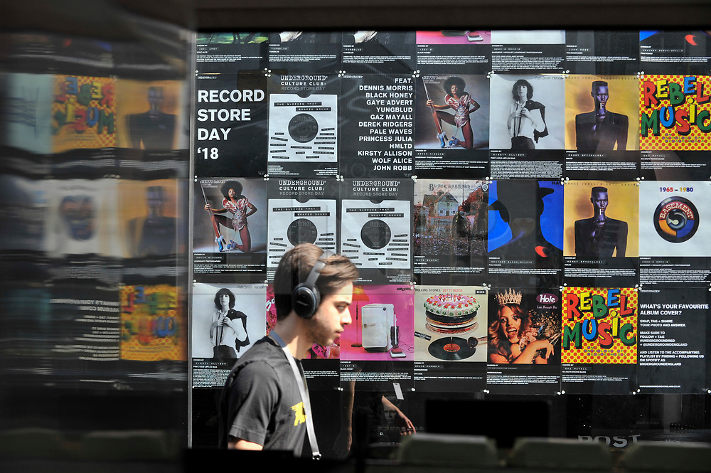 © Licensed to London News Pictures. 21/04/2018. LONDON, UK.  Classic album art is displayed as analogue music fans visit independent record shops in Soho on the 11th annual Record Store Day.  Over 200 independent record shops all across the UK come together to celebrate the unique culture of vinyl music with special releases made exclusively for the day.  Photo credit: Stephen Chung/LNP