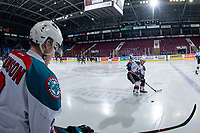 KELOWNA, CANADA - FEBRUARY 23:  Lassi Thomson #2 and Schael Higson #21 of the Kelowna Rockets warm up on the ice against the Kamloops Blazers on February 23, 2019 at Prospera Place in Kelowna, British Columbia, Canada.  (Photo by Marissa Baecker/Shoot the Breeze)