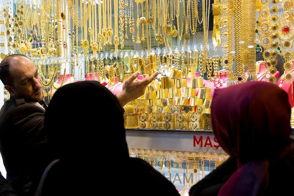 Muslim women at jewelry shop in The Grand Bazaar, Kapalicarsi, great market in Beyazi, Istanbul, Turkey