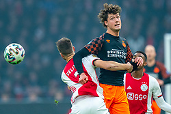 Joël Veltman #3 of Ajax and Sam Lammers #14 of PSV Eindhoven in action during the match between Ajax and PSV at Johan Cruyff Arena on February 02, 2020 in Amsterdam, Netherlands