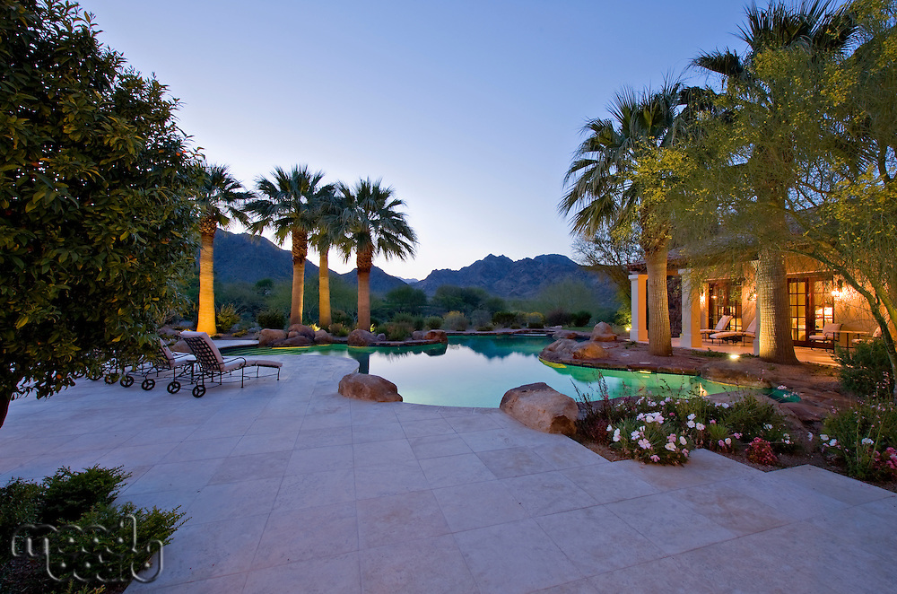 View of mountains with swimming pool from luxury mansion