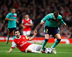 16.02.2011, Emirates Stadium, London, ENG, UEFA CL, FC Arsenal vs FC Barcelona, im Bild Arsenal's Cesc Fabregas (captain) with Barcelona's Gerard Pique  in Arsenal vs Barcelona for the UCL  ,Round of last 16, at the Emirates Stadium in London on 16/02/2011, EXPA Pictures © 2011, PhotoCredit: EXPA/ IPS/ Kieran Galvin +++++ ATTENTION - OUT OF ENGLAND/GBR and France/ FRA +++++