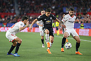 Manchester United Forward Alexis Sanchez battles with Sevilla midfielder Ever Banega (10) during the Champions League match between Sevilla and Manchester United at the Ramon Sanchez Pizjuan Stadium, Seville, Spain on 21 February 2018. Picture by Phil Duncan.