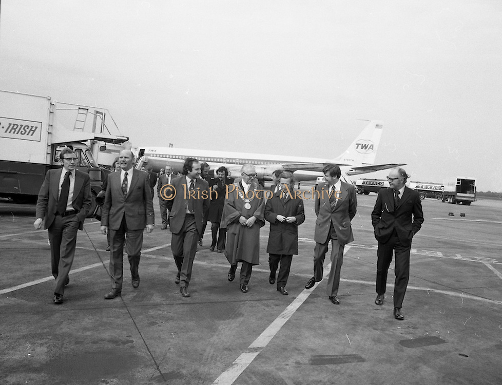 First Direct T.W.A.Flight To Dublin.    (G68)..1974..02.05.1974..05.002.1974..2nd May 1974..Today saw the first direct trans-Atlantic flight direct to Dublin airport from the U.S.A. T.W.A. (Trans World Airways) were the flight operators and the aircraft used was a Boeing 707, registry number N799TW..Picture of the welcoming party,passengers and dignitaries as they make their way to the reception being held in the terminal building of Dublin Airport.