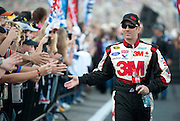 Greg Biffle (16) of the 3M Ford greets fans before the Sprint Cup NRA 500 at Texas Motor Speedway in Fort Worth on Saturday, April 13, 2013. (Cooper Neill/The Dallas Morning News)