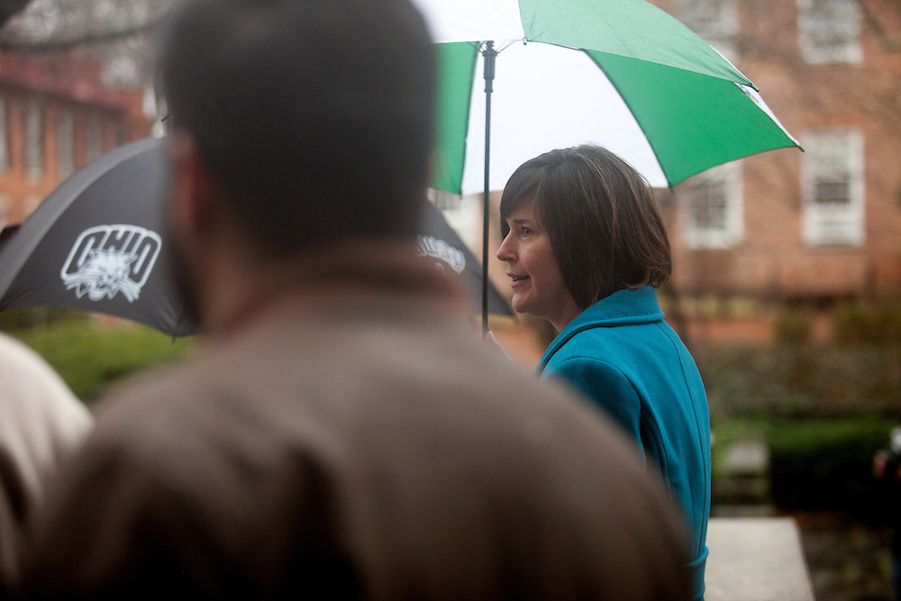 Senior Associate Vice President for Student Affairs and Dean of Students Jenny Hall-Jones stands under her umbrella outside of Alden Library before the Bobcat Unity Walk on Tuesday, Feb. 28, 2017. © Ohio University / Photo by Kaitlin Owens