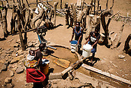 Women collects water for the schoolchildren, fore washing hands before eating their meal.