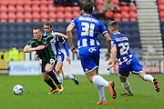Donal McDermott during the Sky Bet League 1 match between Wigan Athletic and Rochdale at the DW Stadium, Wigan, England on 28 March 2016. Photo by Daniel Youngs.