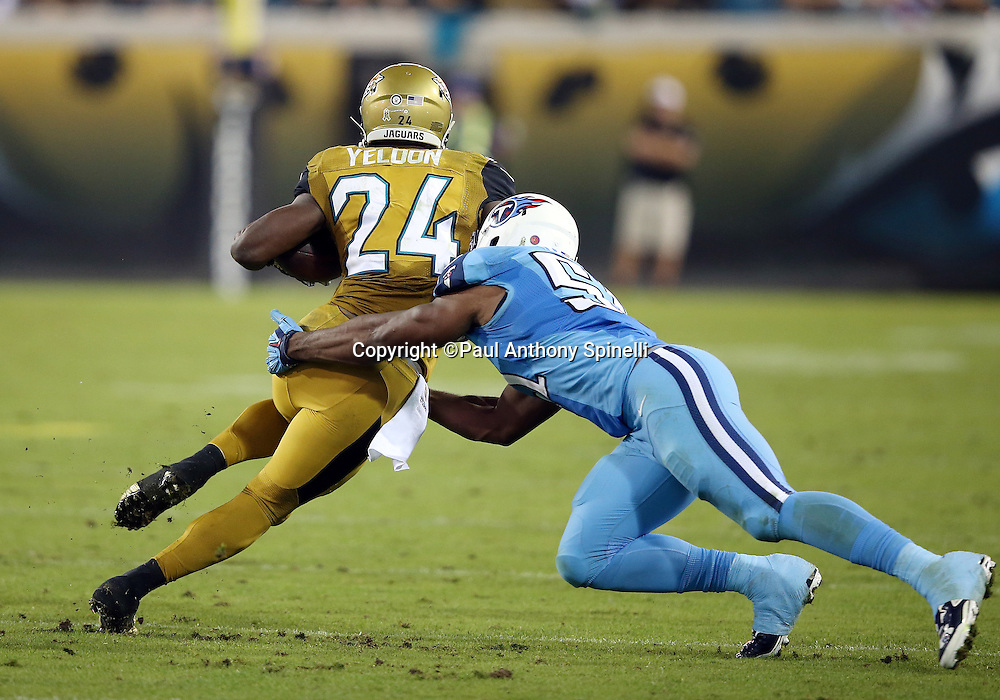 Jacksonville Jaguars running back T.J. Yeldon (24) gets tackled by Tennessee Titans linebacker David Bass (51) as he runs with the ball after catching a third quarter pass for a first down during the 2015 week 11 regular season NFL football game against the Tennessee Titans on Thursday, Nov. 19, 2015 in Jacksonville, Fla. The Jaguars won the game 19-13. (©Paul Anthony Spinelli)