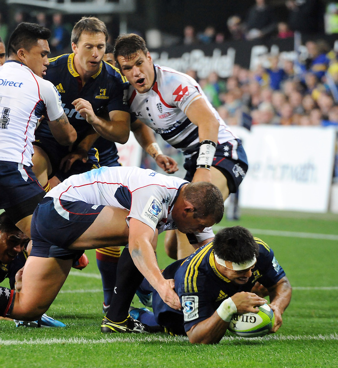 Highlanders' Shane Christie scores in thetackle of Rebels' Toby Smith in the Super Rugby match at Forsyth Barr Stadium, Dunedin, New Zealand, Friday, April 04, 2014. Credit:SNPA / Ross Setford