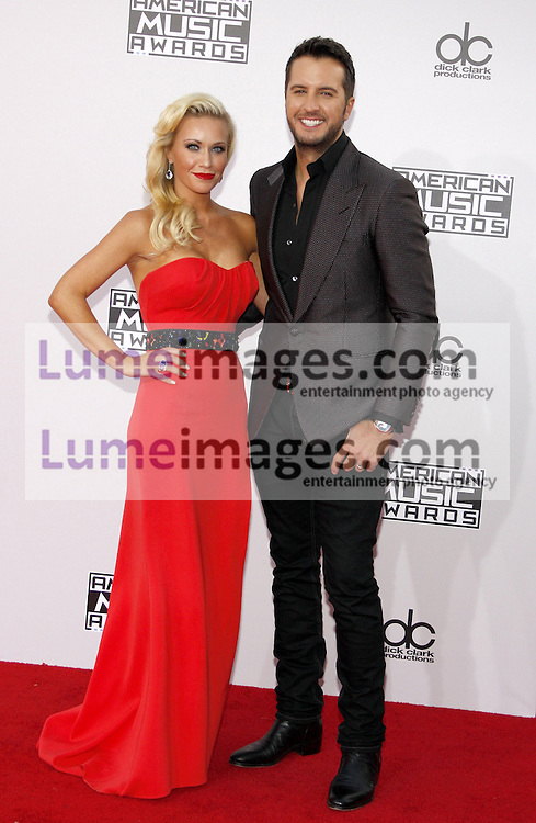 Luke Bryan and Caroline Boyer at the 2014 American Music Awards held at the Nokia Theatre L.A. Live in Los Angeles on November 23, 2014 in Los Angeles, California. Credit: Lumeimages.com