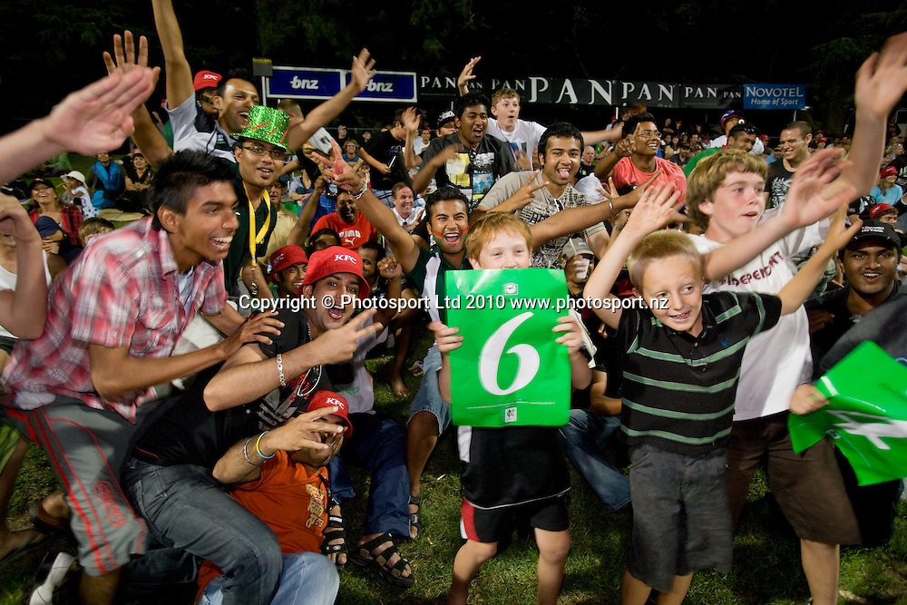 Fans in the crowd celebrate during the National Bank Twenty20 Series cricket match between Bangladesh and New Zealand Blackcaps won by 10 wickets by the Blackcaps at Seddon Park, Hamilton, New Zealand, Wednesday 03 February 2010. Photo: Stephen Barker/PHOTOSPORT