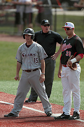 26 April 2014:    Will Farmer, Brian Rodemoyer and umpire Grady Smith at first base during an NCAA Division 1 Missouri Valley Conference (MVC) Baseball game between the Southern Illinois Salukis and the Illinois State Redbirds in Duffy Bass Field, Normal IL