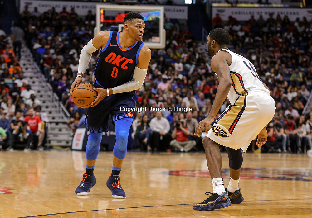 Apr 1, 2018; New Orleans, LA, USA; Oklahoma City Thunder guard Russell Westbrook (0) is defended by New Orleans Pelicans forward E'Twaun Moore (55) during the second half at the Smoothie King Center. The Thunder defeated the Pelicans 109-104. Mandatory Credit: Derick E. Hingle-USA TODAY Sports