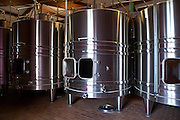 Stainless steel wine vats at Chateau Beau-Sejour Becot at St Emilion in the Bordeaux wine region of France