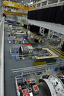 This is the SGT-8000H assembly area. Note the giant yellow crane which rolls back and forth along the ceiling to move the turbine parts.