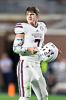 OXFORD, MS - NOVEMBER 26:  Nick Fitzgerald #7 of the Mississippi State Bulldogs is tackled and has his helmet ripped off by Victor Evans #14 of the Mississippi Rebels at Vaught-Hemingway Stadium on November 26, 2016 in Oxford, Mississippi.  The Bulldogs defeated the Rebels 55-20.  (Photo by Wesley Hitt/Getty Images) *** Local Caption *** Nick Fitzgerald; Victor Evans