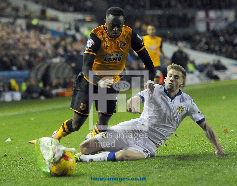 Charlie Taylor of Leeds United tackles Moses Odubajo of Hull City during a blustery Sky Bet Championship match at Elland Road, Leeds<br /> Picture by Graham Crowther/Focus Images Ltd +44 7763 140036<br /> 05/12/2015