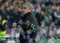 Football - 2016 / 2017 Premier League - West Ham United vs. Manchester United<br /> <br /> Manchester United Manager Jose Mourinho amongst the bubbles at The London Stadium.<br /> <br /> COLORSPORT/DANIEL BEARHAM