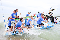 © Licensed to London News Pictures. Participants have a greta time in the sea during Paddle Something Unusual, part of the Paddle round the pier 2015 beach festival taking place on Brighton beach, today June 5th 2015. Photo credit : Hugo Michiels/LNP