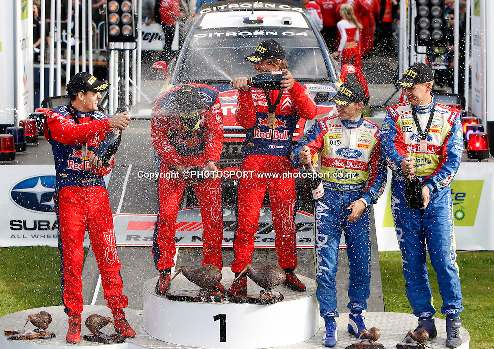 (L-R) 2nd place, Dani Sordo, 1st place, Daniel Elena and Sebastien Loeb, 3rd place, Mikko Hirvonen and Jarmo Lehtinen, spray the champagne.<br />Repco Rally of New Zealand, Day 3, SS16, Mystery Creek, Sunday 31 August 2008. Photo: Renee McKay/PHOTOSPORT