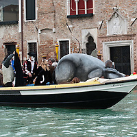 "VENICE, ITALY - FEBRUARY 20: A boat carrying the ""pantegana"" (Mouse) sails along the Grand Canal during the Venetian Feast on February 20, 2011 in Venice, Italy. During the Venetian Feast a traditional water parade sails from San Marco along the Canal Grande to the  district of Cannaregio where there the crowd waits for the Svolo della Pantegana (flight of the mouse)."
