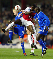 Photo: Scott Heavey.<br /> Arsenal v Chelsea. UEFA Champions League. Quarter Final second leg. 06/04/2004.<br /> Kolo Toure is crowded out by the Chelsea midfield