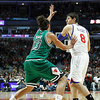 17 March 2012: Philadelphia Sixers center Nikola Vucevic (8) looks to pass the ball past Chicago Bulls center Joakim Noah (13) during the Chicago Bulls 89-80 victory over the Philadelphia Sixers at the United Center, Chicago, Illinois, USA.