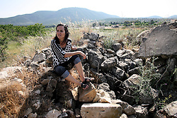 SifSufa - May 5th,  2008 - Raneen Geries, coordinator of the oral history project at zochrot organisation sits on remains that used to be the village of  Safsaf, Northern Israel 10KM from the Lebanese border, May 6th, 2008. Picture by Andrew Parsons / i-Images