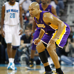 December 29, 2010; New Orleans, LA, USA; Los Angeles Lakers point guard Derek Fisher (2) plays defense against the New Orleans Hornets during the first half at the New Orleans Arena.   Mandatory Credit: Derick E. Hingle