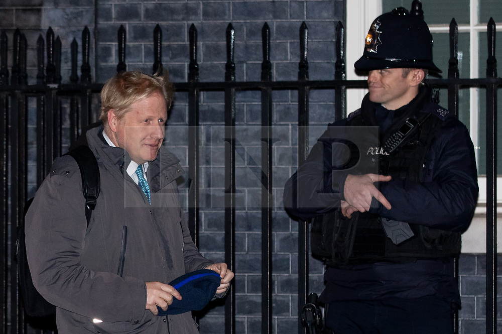 © Licensed to London News Pictures. 07/01/2019. London, UK. Former Foreign and Commonwealth Secretary Boris Johnson (left) leaving 10 Downing Street after attending a drinks reception in Number 10. British Prime Minister Theresa May is currently trying to persuade MPs to back her Brexit withdrawal deal. MPs will be debating the issue this week, with the postponed vote taking place on Tuesday 15th January. Photo credit : Tom Nicholson/LNP