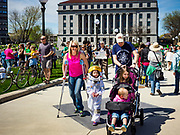 22 APRIL 2017 - ST. PAUL, MN: A family, including a girl in an astronaut suit, walks into the Minnesota March for Science at the State Capitol. More than 10,000 people marched from the St. Paul Cathedral to the Minnesota State Capitol in St. Paul during the March for Science. March organizers said the march was non-partisan and was to show support for the sciences, including the sciences behind climate change and vaccines.      PHOTO BY JACK KURTZ