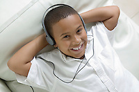 Boy Listening to Music on Headphones