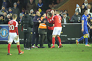 Charlton Athletic Manager Karl Robinson having to be held back by stewards during the EFL Sky Bet League 1 match between AFC Wimbledon and Charlton Athletic at the Cherry Red Records Stadium, Kingston, England on 11 February 2017. Photo by Matthew Redman.
