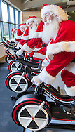 EDITORIAL USE ONLY<br /> Members of The Ministry of Fun's Santa School, dressed as Father Christmas,  work out to get &lsquo;chimney-ready&rsquo; as they attend a special  Santa Boot Camp at the new David Lloyd Club, Newbury PRESS ASSOCIATION Photo. Picture date: Tuesday November 24, 2015. The super intensive pre-Christmas training programme included sessions in David Lloyd&rsquo;s state-of-the-art gym to build strength for all that heavy present lifting, a Santa Spin Session, an Aqua class in the heated pool for stamina and sleigh-ready agility, a bespoke &lsquo;Legs, Bums and Tums&rsquo; class with the emphasis on Santa-sized &lsquo;Tums&rsquo; &ndash; and Yoga. Photo credit should read: Chris Ison/PA Wire