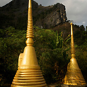 Thai stupas located at the entrance to the Tham Sakoen national park, Thailand. The park is located in Pa Namyoaw and Pa Namsuad forest reserves in Song Kawae district in the northern part of Nan province, close to Laos.