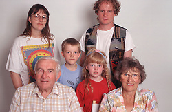 Portrait of family group with three generations,