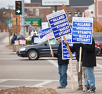 Republicans and Democrats stake out their street corners during the final day of campaigning in downtown Laconia November 1, 2010.