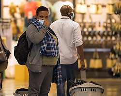 © Licensed to London News Pictures. 24/07/2020. London, UK. A shopper wearing a face mask at Primark on Oxford Street in central London, on the day that the wearing of mask in shops becomes compulsory. The UK Government has published formal guidance on spaces where the wearing of masks will now be mandatory, including in shops, supermarkets and shopping centres. Photo credit: Ben Cawthra/LNP